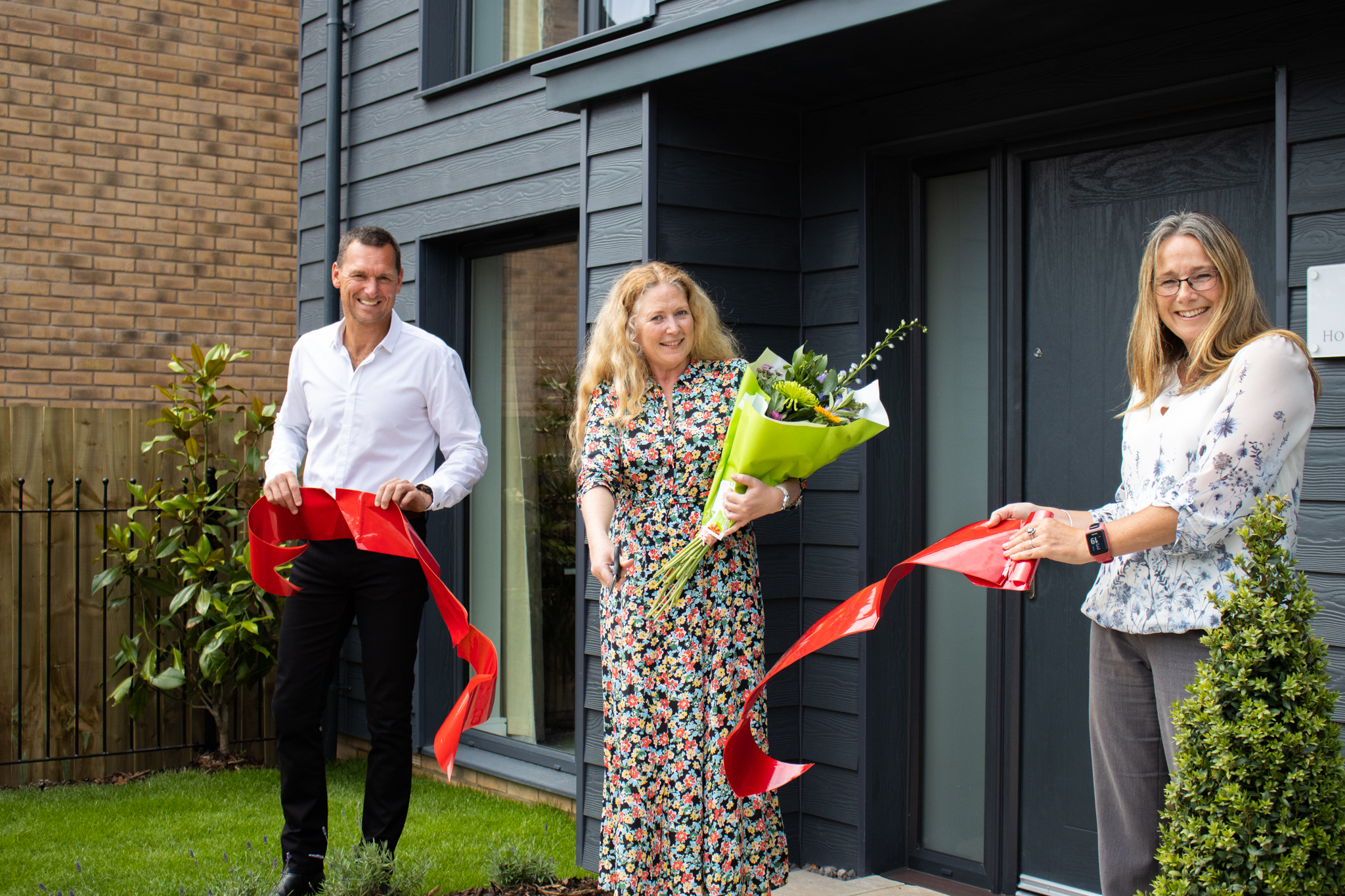 School teacher is guest of 'honour' at official opening at Baker Estates' show home in Bridport
