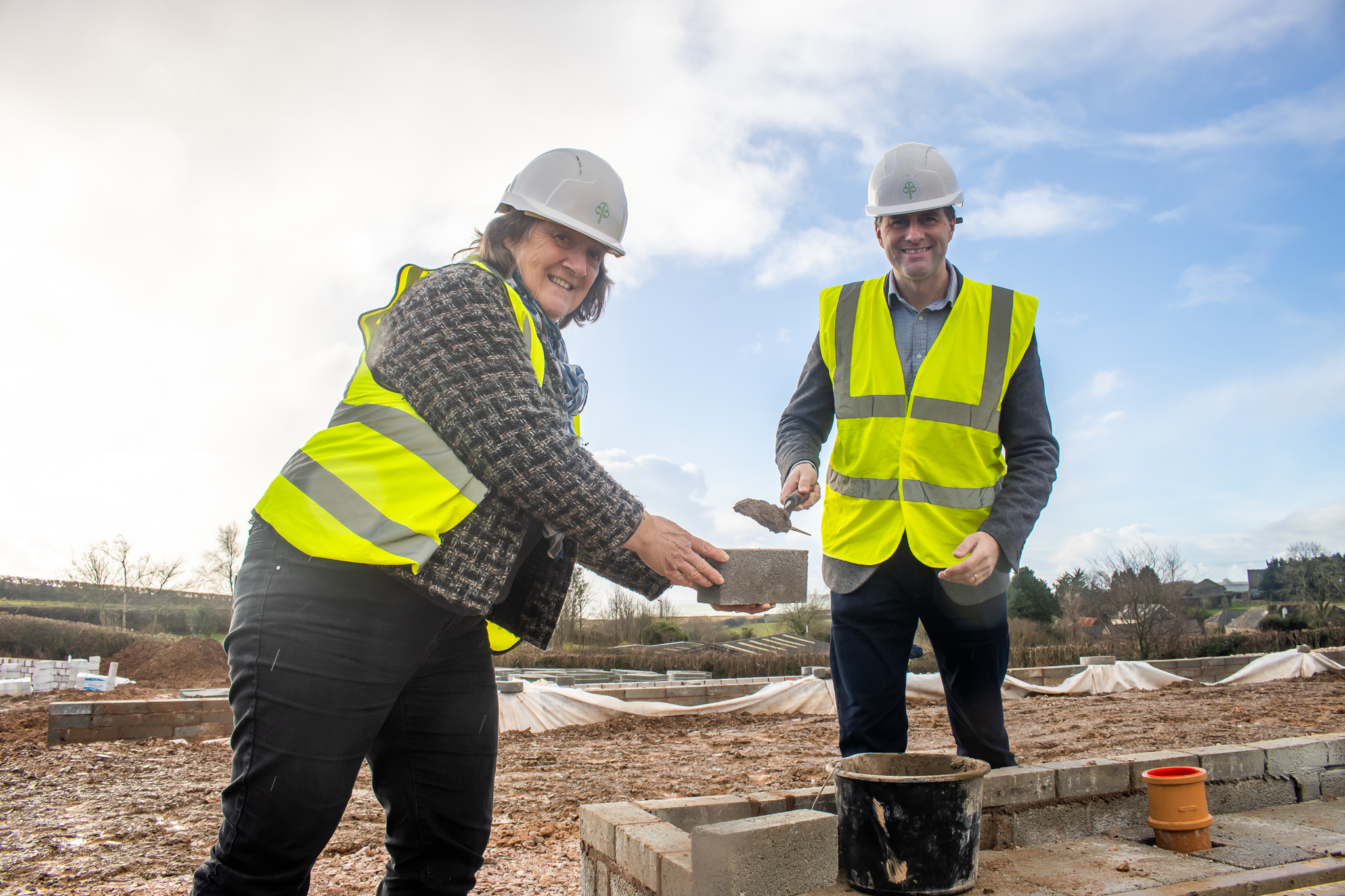 Councillor helps to lay first brick at Baker Estates' landmark housing development in Dartmouth